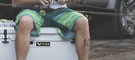 Vibe Kayaks ambassador man fishing rode sitting cooler